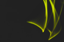 green streaks of light on black
