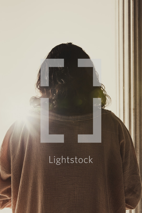 Jesus  standing near a column facing the crowd at the Praetorium
