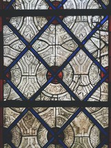 red, blue, and white patterned stained glass window