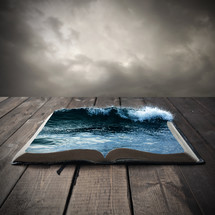 ocean on the pages of an open Bible