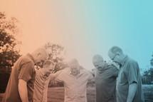 men's group praying