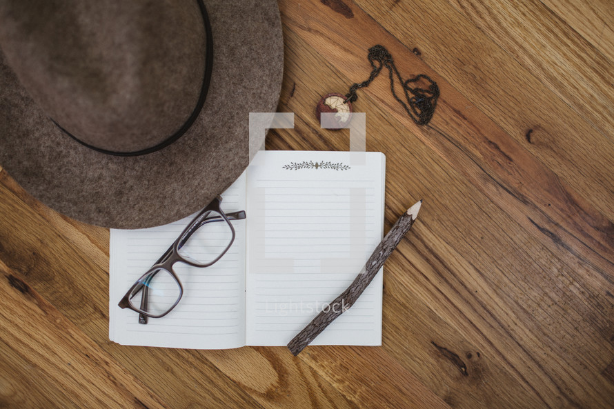 journaling items on a wood floor
