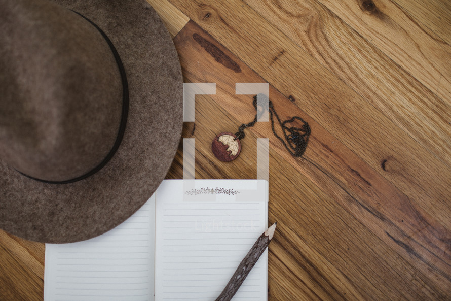 journaling supplies on a wood floor