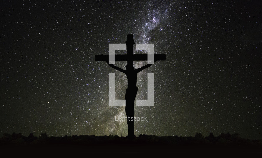 Jesus on the cross under a starry sky