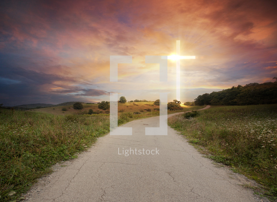 a cross of light at the end of a road