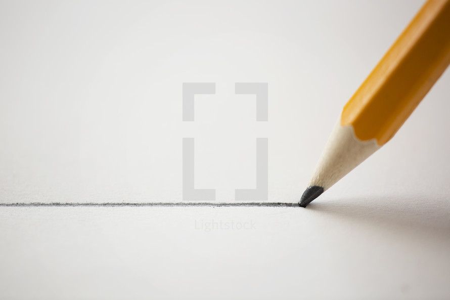 pencil drawing a straight line on a piece of paper.