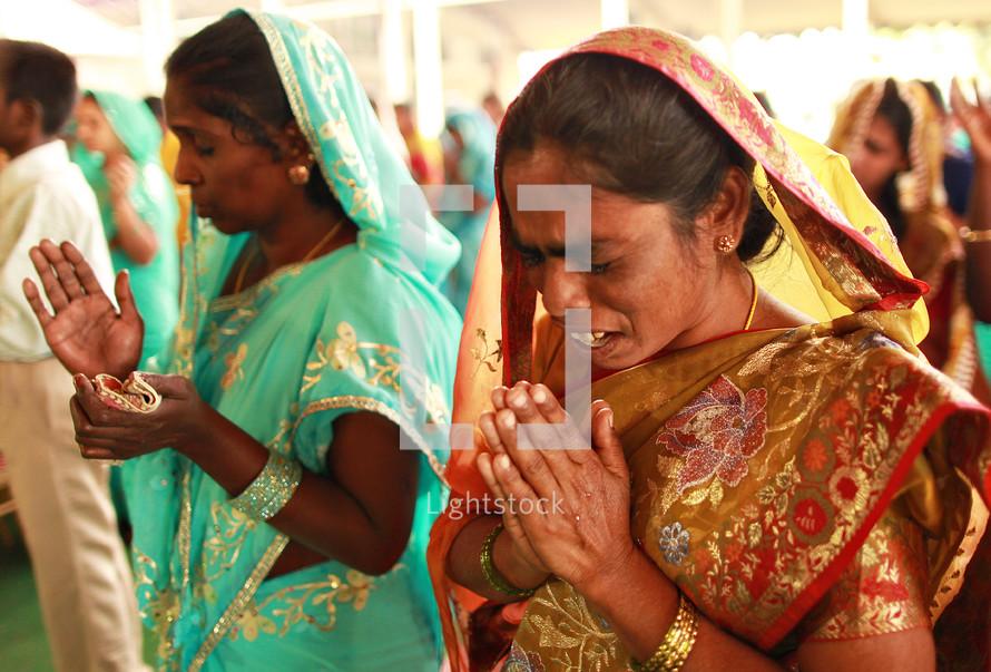 women in prayer in India
