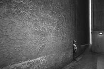 looking up in dark alleyway