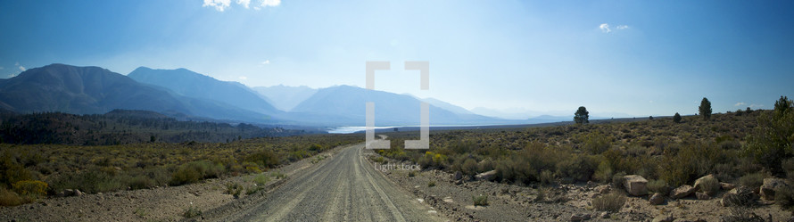 dirt road with a mountain view