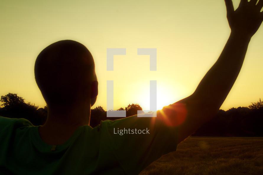 Man worshipping at sunrise