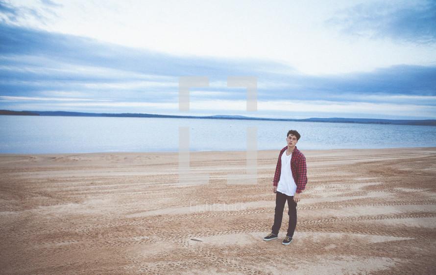 man standing on a beach