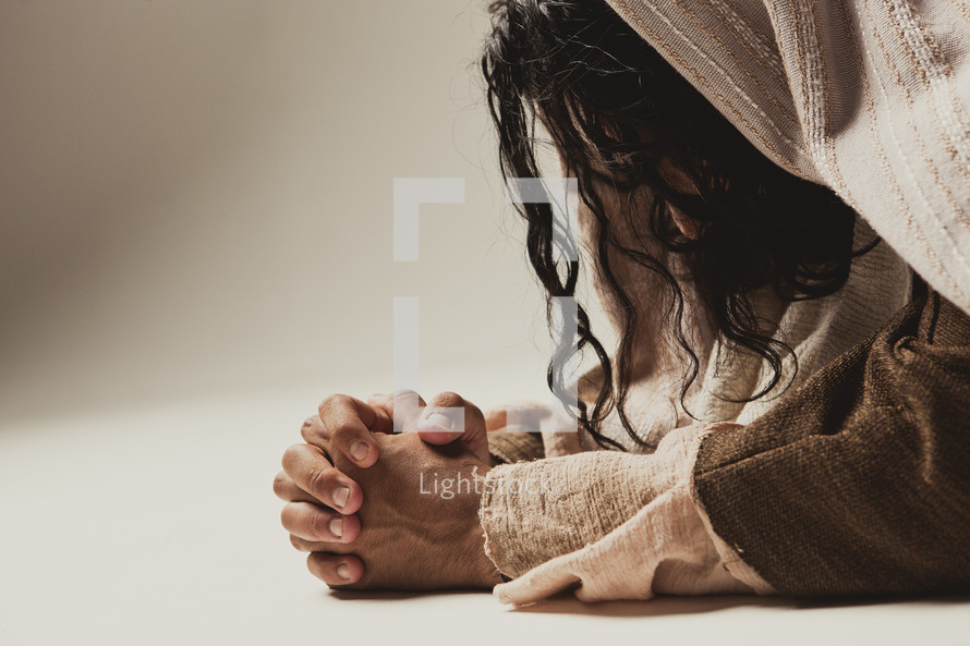 Jesus praying - isolated on white