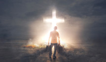 a man with baggage standing in front of a glowing cross
