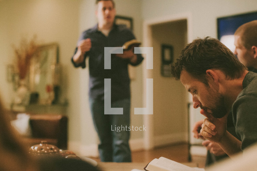 men gathered at a bible study
