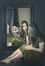"""A woman looking into a mirror and asking """"who am I?"""""""