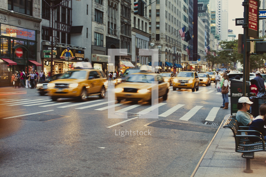 Taxi cabs driving on a street