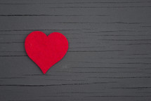red heart on gray wood boards