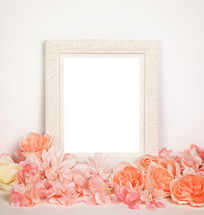 white frame and peach and peace flowers