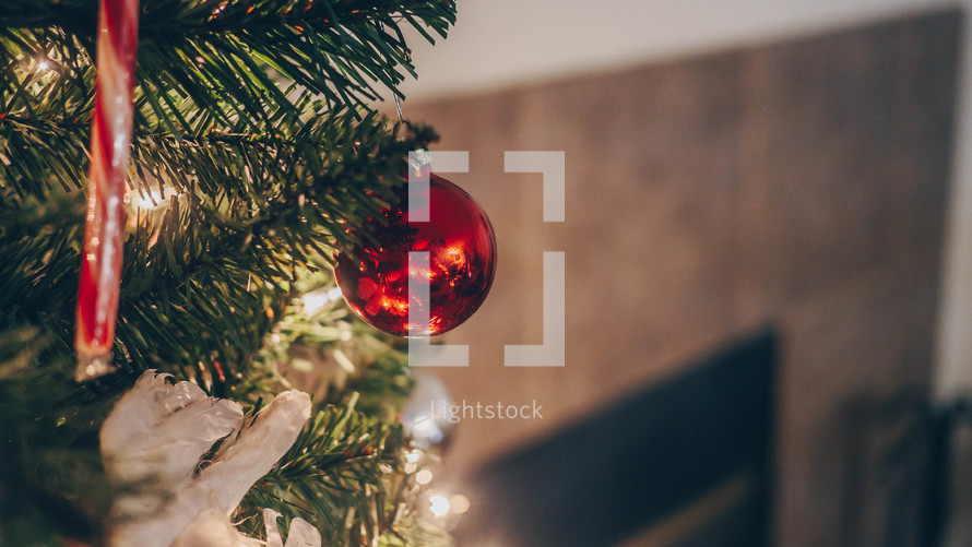 ornaments on a Christmas tree and fireplace view