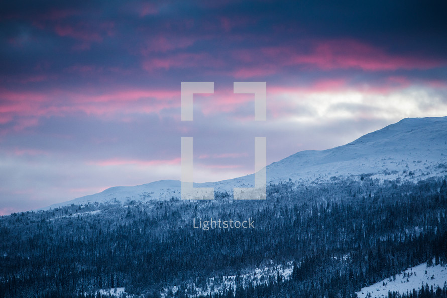 purple sky over snowy mountains