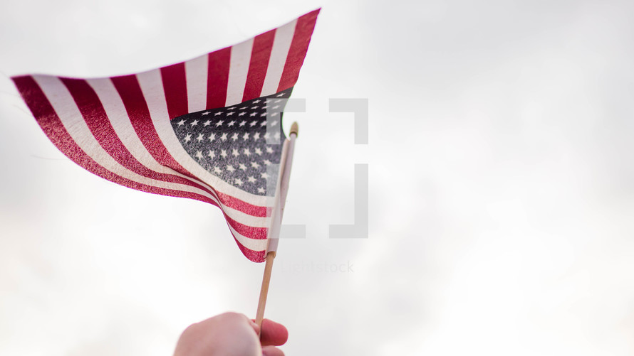 holding up an American flag
