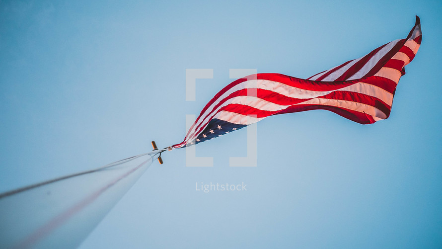 looking up at an American flag on a flag pole
