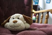 stuffed animal on a rocking chair