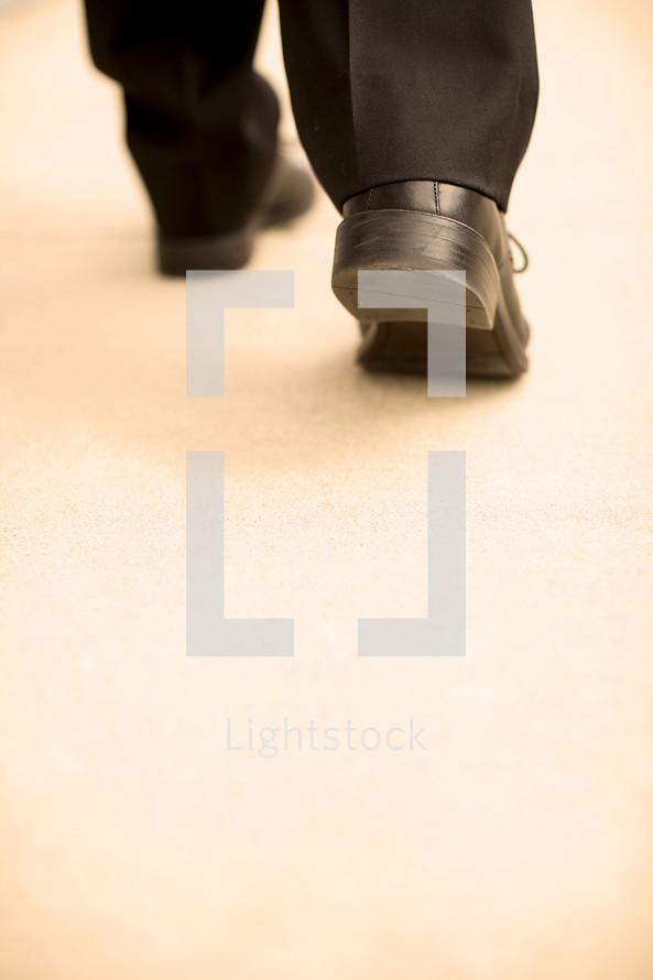 businessman walking with purpose