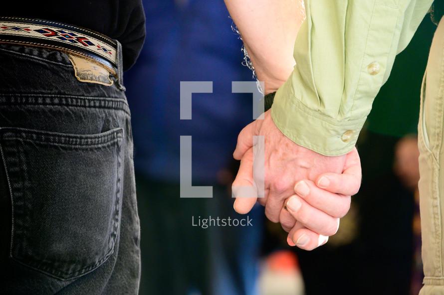 holding hands for prayer