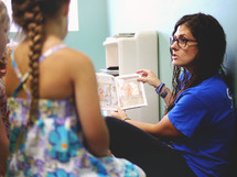 a teacher reading to her students