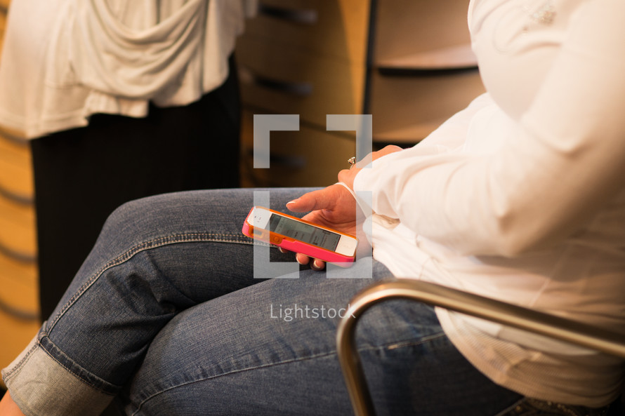 woman checking her phone