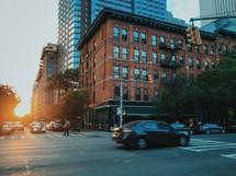 man crossing a crosswalk on a city street
