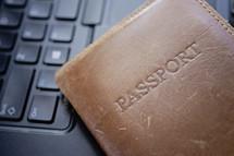 a passport on a keyboard