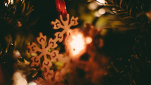 wooden snowflake ornaments on a Christmas tree