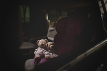 teddy bears in a carseat
