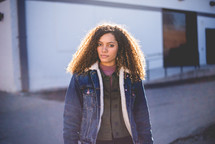 a young woman in a denim coat