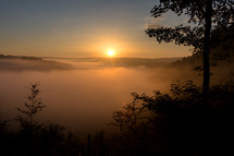 Belgium mountains in fog at sunrise