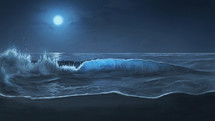 waves washing onto a shore under moonlight