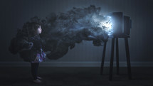 little girl watching tv enveloped in smoke