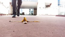 man walking past a banana peel