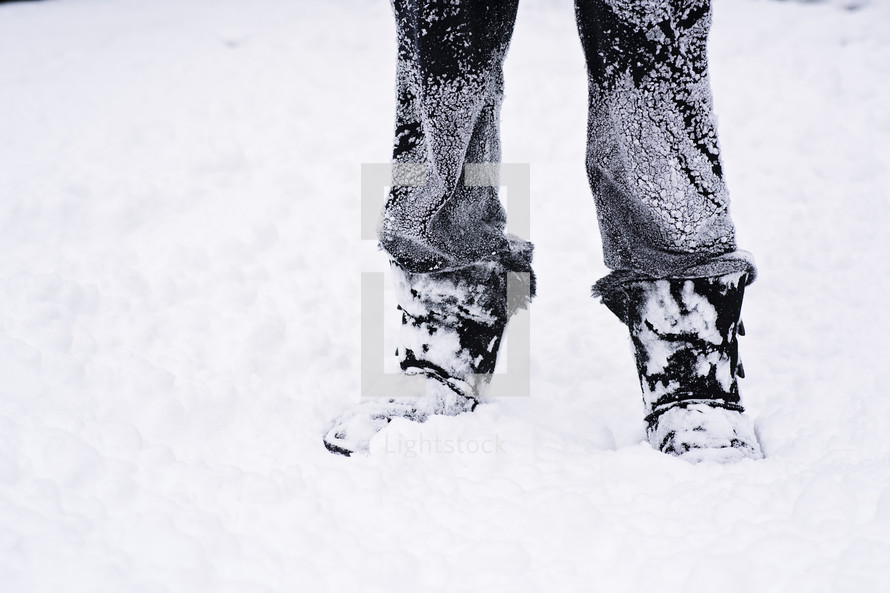 snow on pant legs and boots