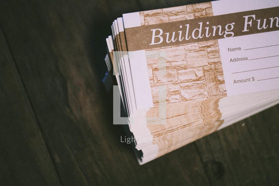 Building fund envelopes stacked