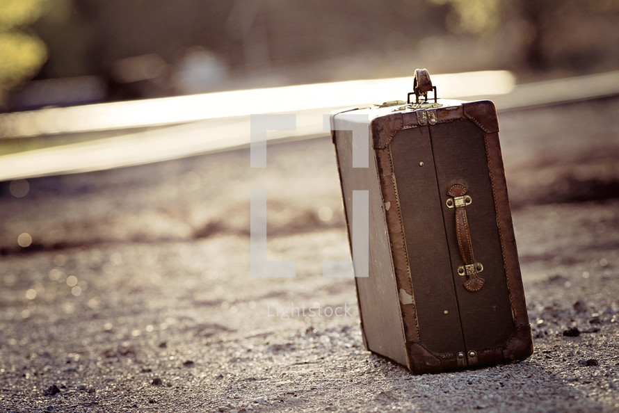 suitcase on a dirt road