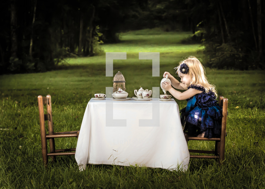 Little girl having tea party with guests expected.