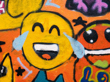 a smiley face emoji graffiti