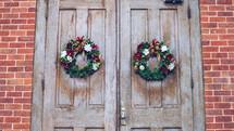 Christmas wreaths on wood doors