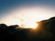 water splashing at sunset