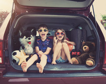 kids sitting in the back of an SUV