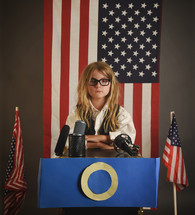 girl standing at a podium running for president