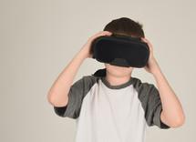 a child using VR glasses